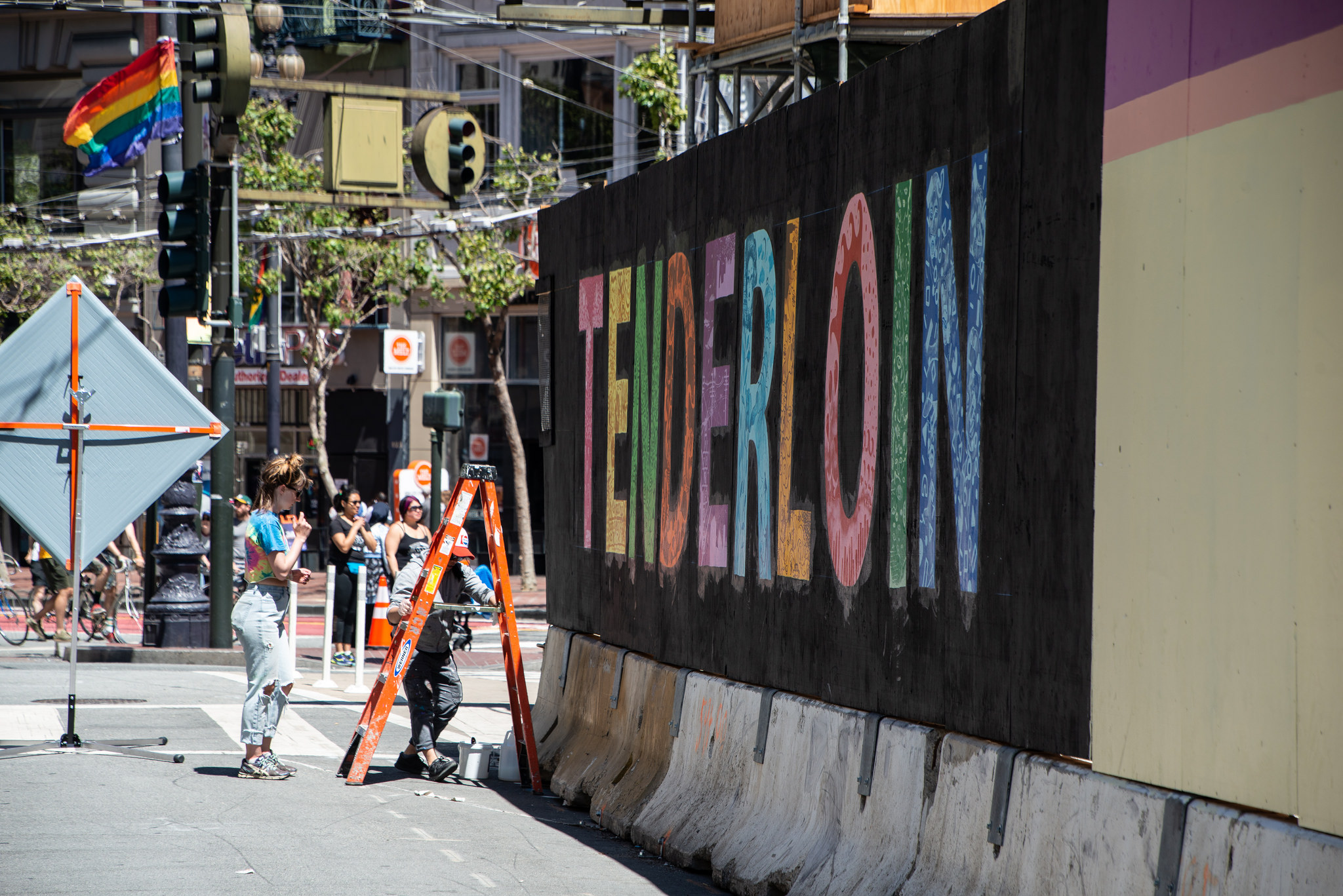 "Our mural from the side, showing the word ""TENDERLOIN"" in colorful handpainted letters"